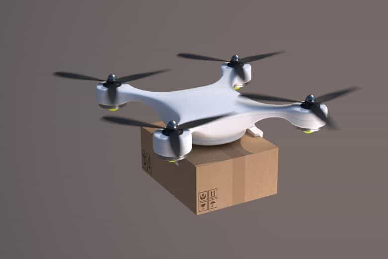 Quadcopter drone carrying parcel